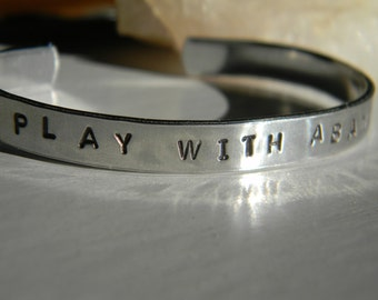 Play With Abandon silver hand stamped bracelet