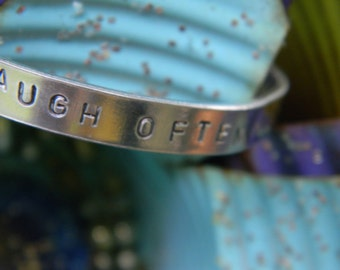 Laugh Often And Much.  Silver Bangle