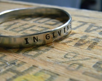 In Giving We Heal Ourselves, hand stamped Silver Bracelet
