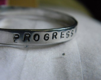 Progress not perfection,  silver hand stamped bracelet
