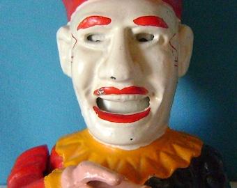 "funky old   ""Humpty Dumpty""  mechanical cast iron clown bank....."