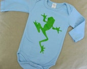 Long sleeve onesie organic cotton in skye blue with  green tree frog. 3-6 months