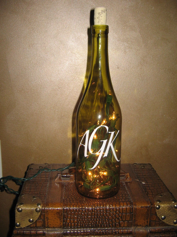 Lighted custom monogram wine bottle centerpiece wedding for Bottle centerpieces