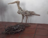 Driftwood endangered bird and nest with stone eggs