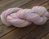 Hand-dyed, self-striping sock yarn, pink and lemon