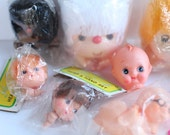 Vintage doll heads, lot of nine