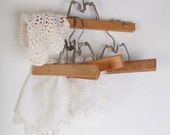 Wooden pants hangers, set of four