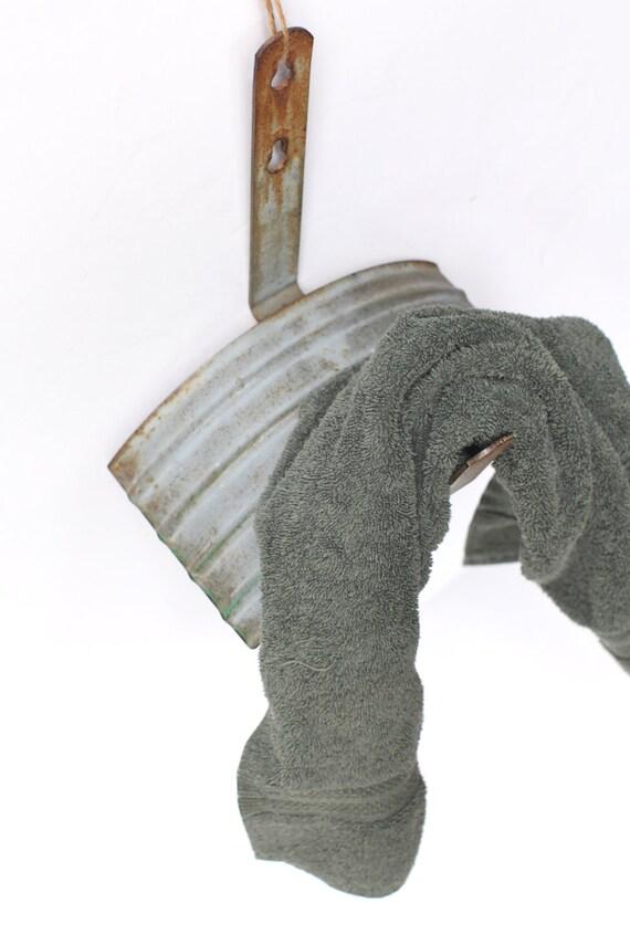 Repurposed hose holder, towel holder