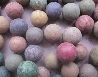 3 Antique Clay Marbles