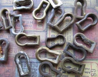 2 Vintage Brass Keyholes