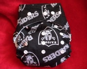 SassyCloth one size pocket diaper with Oakland Raiders black cotton print. Made to order.