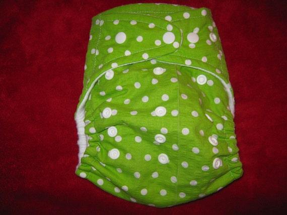 SassyCloth one size AIO pocket diaper with white polka dots on green cotton print.