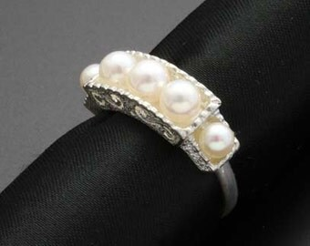 Pearl ring with arabesque textured silver. (Custom order)