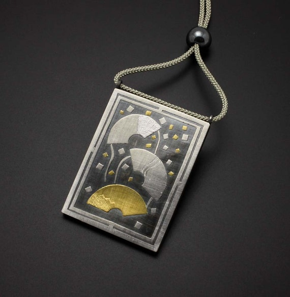 Dancing fans sterling pendant