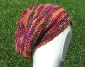 Slouch Hat beanie stocking cap or beret multicolored purple pink yellow red hand knit with a seed stitch ribbing