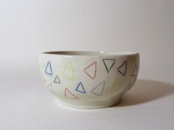 Triangle bowl, multi-colored triangles all over, geometric and minimal