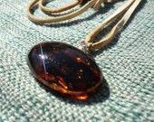 Chiapas Amber Oval Pendant on Deerskin Leather Strap
