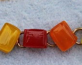 Arm candy glass bracelet in yellow, orange, and red