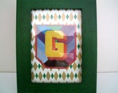 Letter G made with vintage paper
