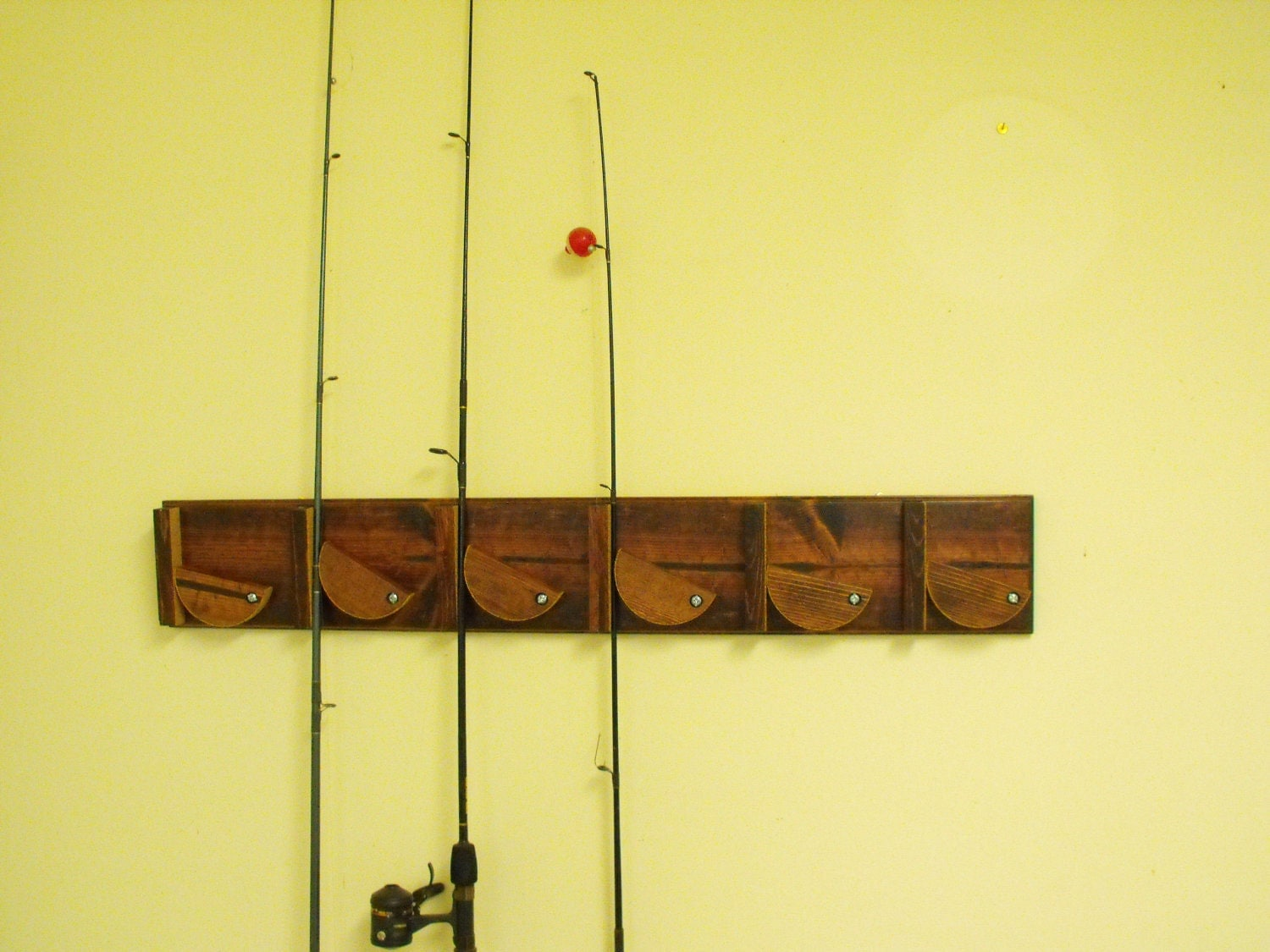 Fishing pole holder wall mounted for Wall fishing tools