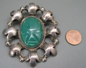 Vintage Large Mexican Sterling Carved Malachite Face Brooch or Pendant from Far Fan