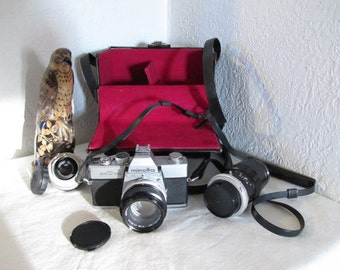 1970s Minolta SRT 100 Camera - original case and two extra lens