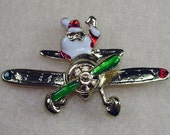 Santa Flying Gold Tone  Moving Prop in Red and Green Costume Brooch Pin