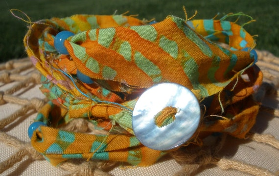Orange and Yellow Batik Fabric Beach Layered Wrap Bracelet With Blue Glow In The Dark Beads