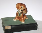Vintage Puppy Dog figurine with green bow