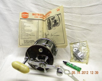 vintage penn reel 309m, with box and supplies