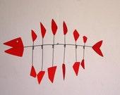 Red Metal Fish  Kinetic sculpture.