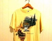Vintage Early 90s Pastel Yellow Maggie Valley T-Shirt