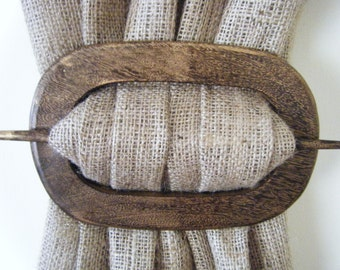 Curtain holdback in oval distressed wood finish at curtains by jackie