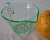 Green depression glass measuring cup