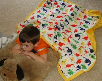 """Yellow dinosaurs flannel blanket 43"""" X 53""""  child cozy double layer quilted"""