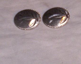 vintag clip on earrings silvertone cut