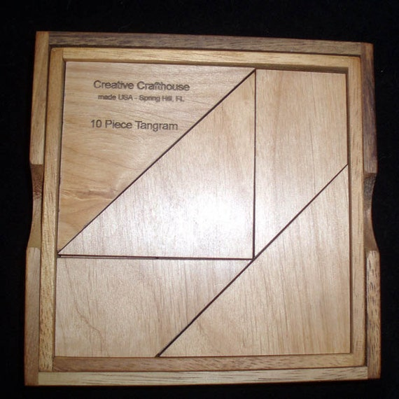 tangram 10 piece with base & cover.  Rare version will make 190 shapes.  Solutions provided