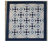 blue and white shoe fly quilt top