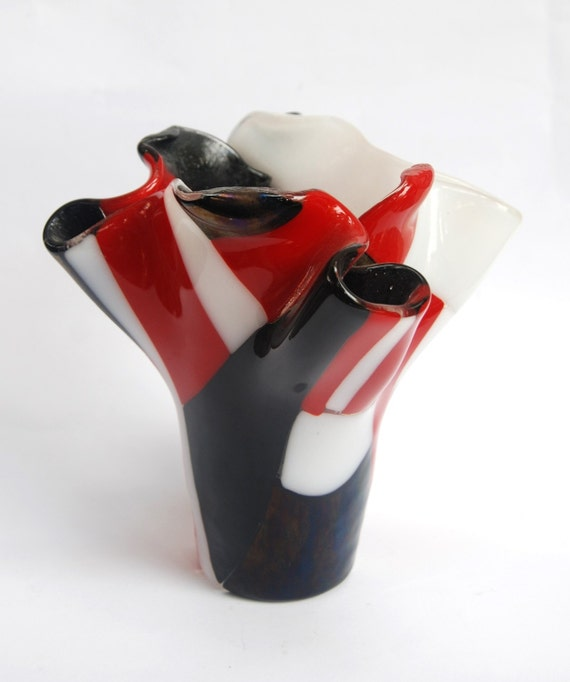 A red, white and black glass vase handmade by dalit glass
