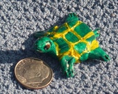 Miniature turtle handmade in USA from a lump of clay maybe the worlds tiniest turtle