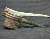 Potato Ricer or masher, green handles kitchen collectibles