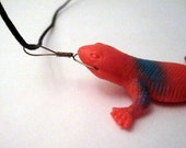 Lizard pendant, red and blue on waxed cotton cord