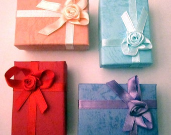 Add a gift box - red, blue, pink or purple
