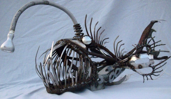 Scrap metal angler fish sculpture with working light