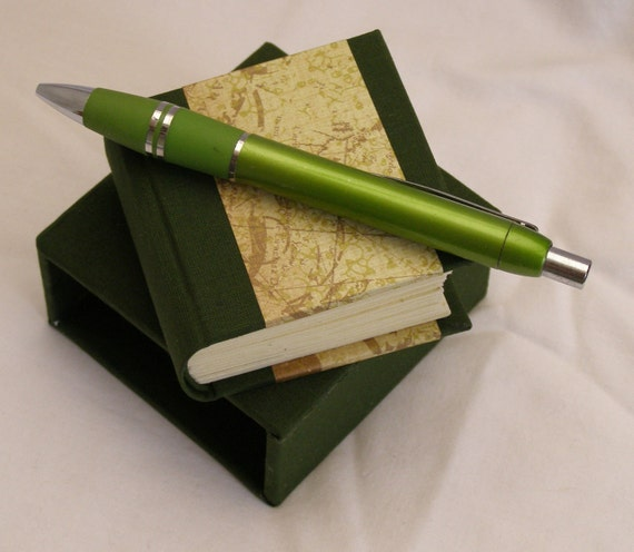Miniature handmade blank book and slipcase in dark green with decorative paper detail