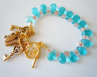 Blue and pink glass bracelet with charms  B035