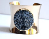 Bead embroidered textured cuff in gold and midnight blue