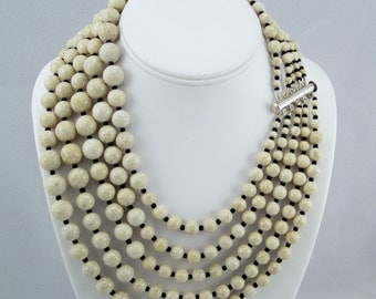 Dancing Multistrand Beige Riverstone and Black Seed Bead Necklace with Sterling Silver Clasp