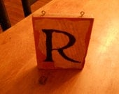 Sign with initial 'R'