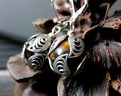 Earrings with tiger amber.